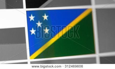Solomon Islands National Flag Of Country. Solomon Islands Flag On The Display, A Digital Moire Effec