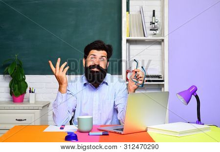 College Student At Campus. World Teachers Day. Teacher Job. Education. Student Preparing For Test Or