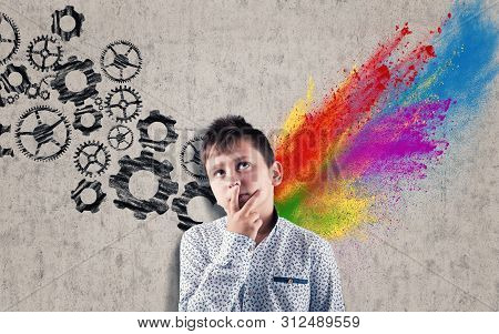 Thoughtful Kid In Front Of A Wall Drawn And Divided By Brain Hemispheres. Creative Half And Logical