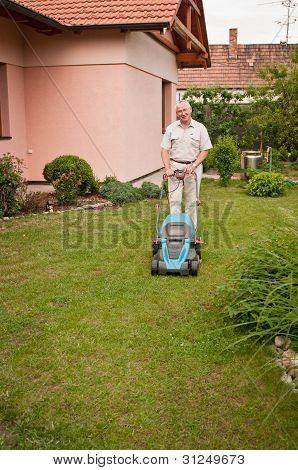 Senior man with lawn mower