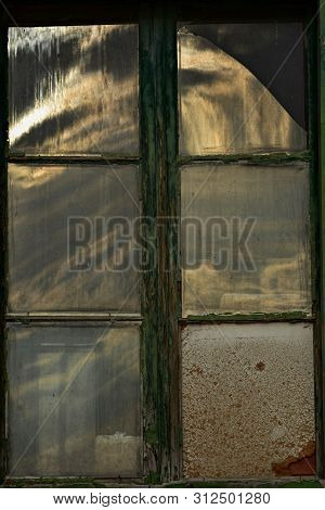 Old broke wooden window on old house wall/ Architecture details/ Vintage poster