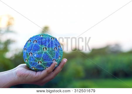 Hand Holding Simulated World With Global Structure Networking Social Network Diagram Which Contain P