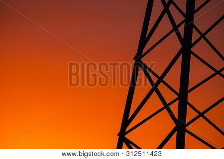 Silhouette Of A Fragment Of Electro Support At Sunset Abstract Color