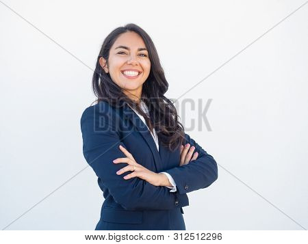Cheerful Successful Businesswoman Posing Over White Background. Proud Young Latin Woman In Office Su