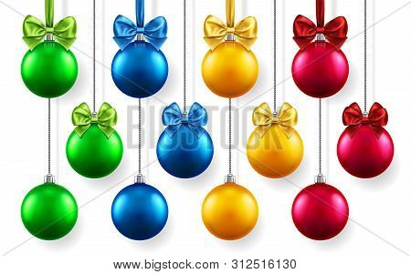 Christmas Or New Year Realistic Toys With Bows Hanging On Chains. Merry Christmas Fir Tree Decoratio