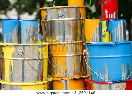 The Used Paint Cans. Colorful Paint Buckets.
