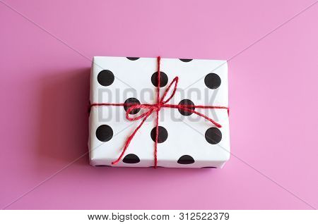 Gift Wrapping. Packed Gifts, Boxes White Paper With Black Polka Dots, Paper For Gifts, On A Pink Bac