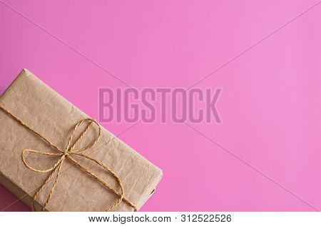 Gift Wrapping. Packed Gifts, Boxes, Paper For Gifts, On A Pink Background. Gifts For Valentines Day,