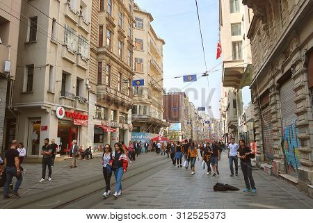 Istanbul, Turkey - May 15, 2019: Pedestrian Tourist Street Istiklal. Istiklal Street Is The Most Pop
