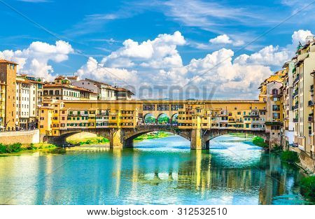 Ponte Vecchio Stone Bridge With Colourful Buildings Houses Over Arno River Blue Turquoise Water And