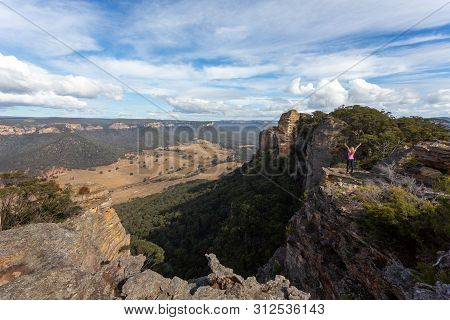 Adventurous Hiker Reaching The Top Slab Of Donkey Mountain With Spectacular Views Over The Mountain