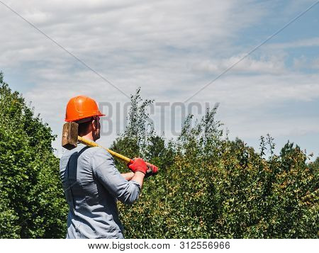 Man Holding A Hammer In The Park