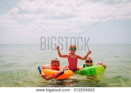 Happy Kids-boy And Girls-enjoy Swimming At Beach