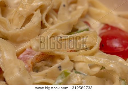 Closeup To Alfredo Spaghetti Pasta With Red And Green Pepper