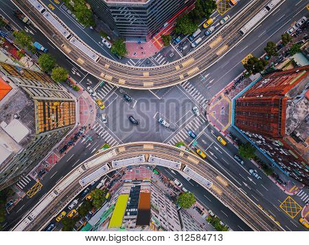 Aerial View Of Cars And Trains With Intersection Or Junction With Traffic, Taipei Downtown, Taiwan.