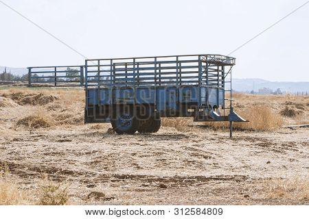 Blue Farm Trailer Open Door On Dried Grass
