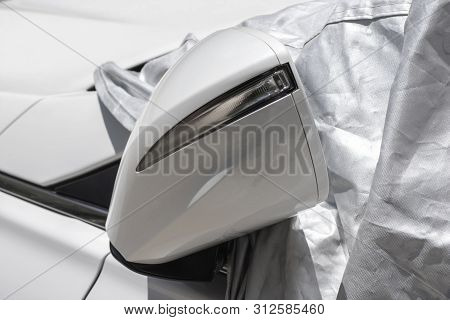 Closeup To A Car Mirror With Car Sun Protect Covered