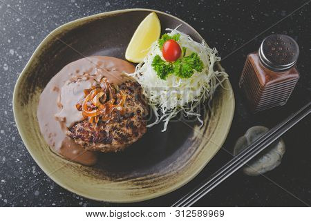 Japanese Style Hamburger Grilled With Gravy Sauce.