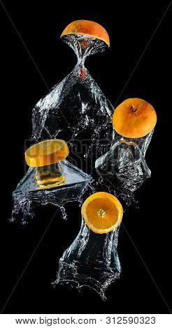 Water Droping Slice Orange Fruits.