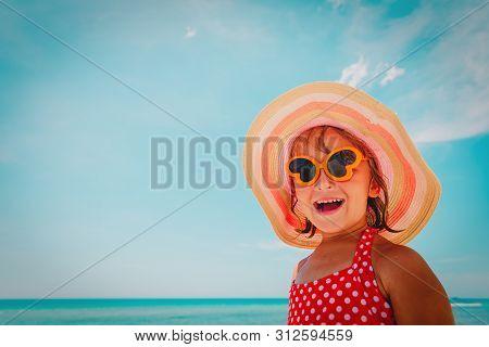 Happy Little Girl Enjoy Summer At Beach