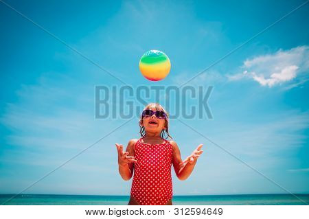 Happy Cute Girl Play With Ball On Beach Vacation