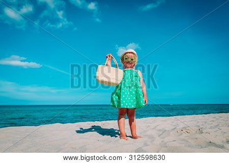 Cute Little Girl With Bag On Beach Vacation