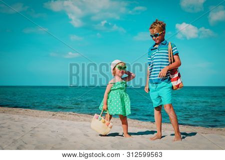 Happy Girl And Boy Play With Toys On Beach