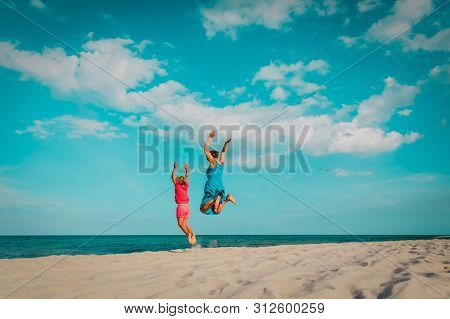Happy Family- Mom And Daughter- Jumping On Beach