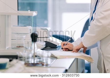 Laboratory Research. Scientist With Test Tube Making Research In Clinical Laboratory.