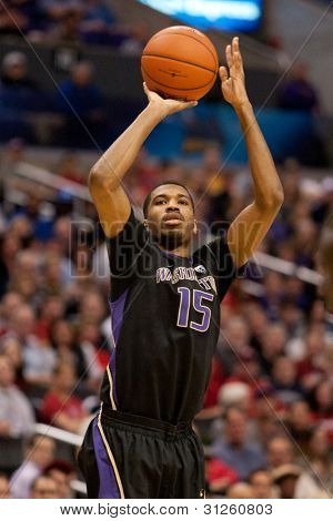 LOS ANGELES - MARCH 12: Washington Huskies G Scott Suggs #15 in action during the NCAA Pac-10 Tournament basketball championship game on March 12 2011 at Staples Center in Los Angeles, CA.