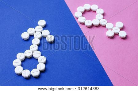 Sign Of Man And Woman From Pills On Colored Background. Concept Of Female And Male Health And Sexual