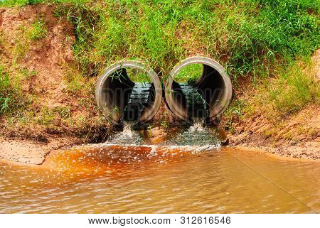 Brown Sewage Drainage Pipes Have A Foul Odor, Factory Waste And Urban Areas Are Drained Into Public