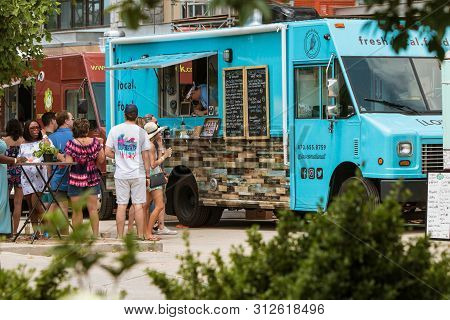 Atlanta, Ga / Usa - May 19:  People Wait In Line And Order From A Food Truck Parked At The Old Fourt
