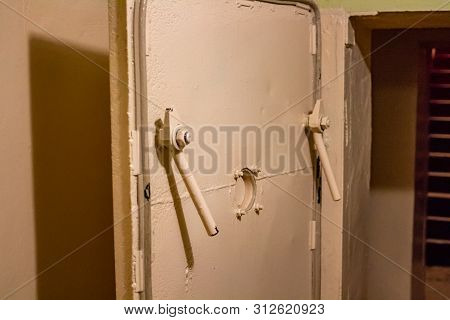 Hermetic Doors Made Of Thick Metal In The Old Bomb Shelter Under The School