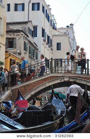 Venice September 13: Busy Canalside and Bridge in Venice on September 13, 2011