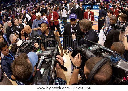 LOS ANGELES - MARCH 12: Washington Huskies G Isaiah Thomas #2 (L) & Washington Huskies head coach Lorenzo Romar (R) after the NCAA Pac-10 Tournament basketball championship game on March 12 2011 in Los Angeles, CA.