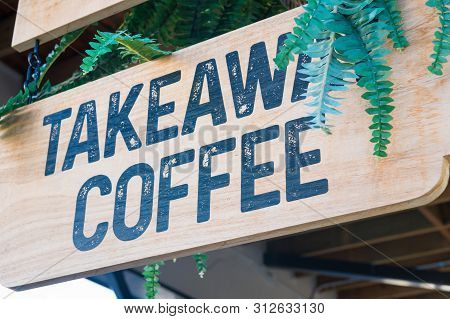 Takeaway Coffee Sign Over Wooden Board At Coffee Shop Entrance