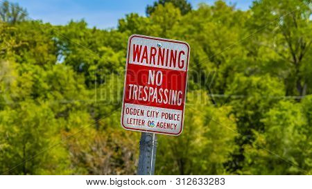 Panorama Frame Sign That Reads Warning No Trespassing Ogden City Police Letter Of Agency