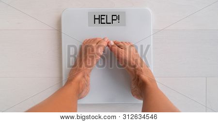 HELP weight scale showing the word help for woman having trouble losing weight needing help of a nutrition professional dietitian advice for healthy eating weight loss.