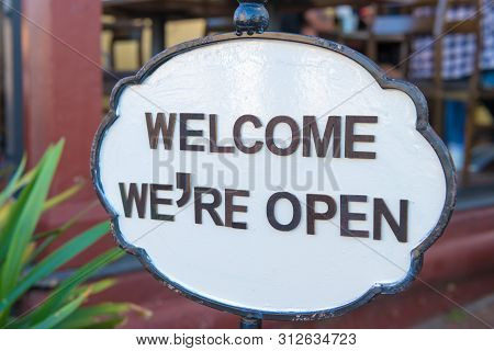 Welcome We Are Open Sign At Restaurant Entrance, Hospitality Concept