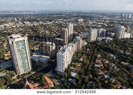 Aerial view of condos, apartments and houses along Wilshire Blvd near Westwood in Los Angeles, California.