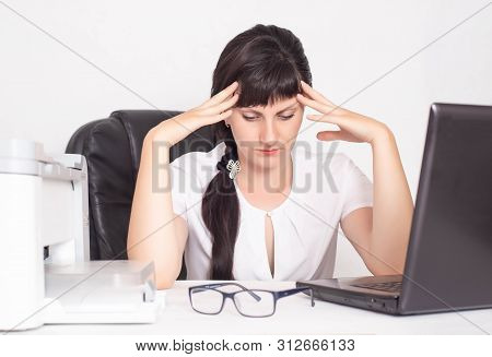 Office Worker Girl, Business Woman Holding Her Head A Concept Of Headache And Anxiety Due To Stress