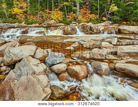 Swift River cascades at autumn in White Mountain National Forest, New Hampshire, USA. Fall in New England.
