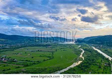 Aerial Summer Landscape Of Populated Valley In Romanian Carpathians, Bistrita River Scene