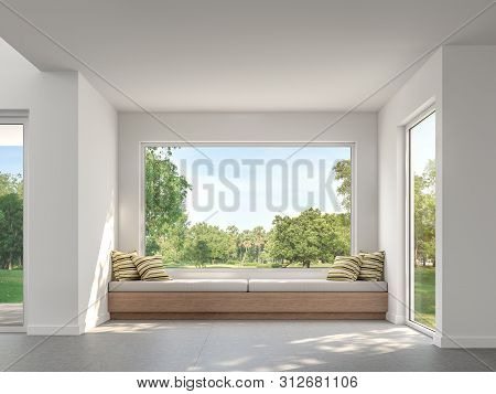 Modern Living Room With Garden View  3d Render,there Are White Wall,concrete Tile Floor,decorate Wit
