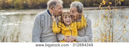 Banner, Long Format Senior Couple With Baby Grandson In The Autumn Park. Great-grandmother, Great-gr