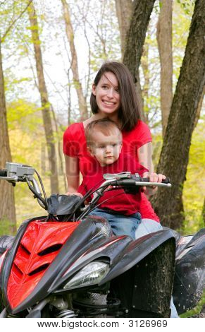 Woman And Child On Atv