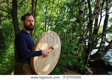 A Bearded Man Plays Drums In Forest Emotional Meditating Lifestyle. Introspection Relaxing