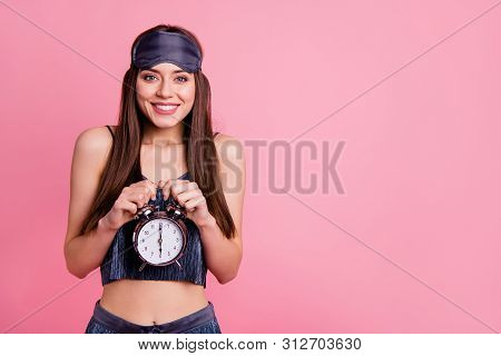 Portrait of nice attractive lovely groomed shine adorable lovable fascinating cheerful straight-haired girl holding in hands six 6 oclock sporty healthy life lifestyle isolated over pink background poster