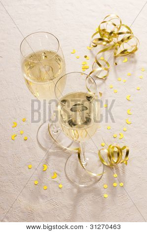 Two Champagne Glasses With Gold Ribbon And Copy Space